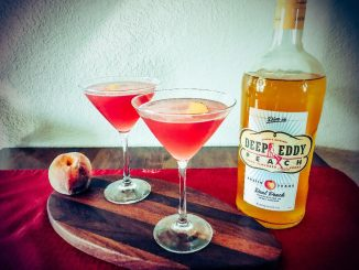 Peach Cosmopolitan Martini made with Deep Eddy Peach Vodka, Cointreau, Cranberry Juice, Lime Juice, and Simple Syrup