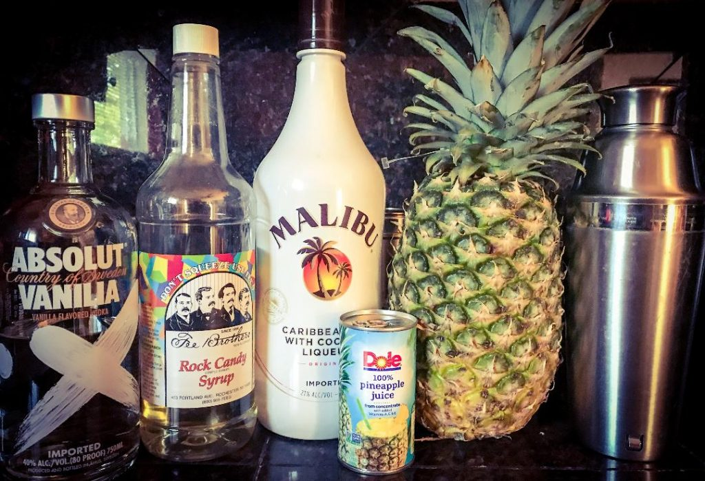 The Pina Colada Martini made with Absolut Vanilla Vodka, Malibu Coconut Rum, Pineapple Juice, Simple Syrup, and fresh pineapple for garnish