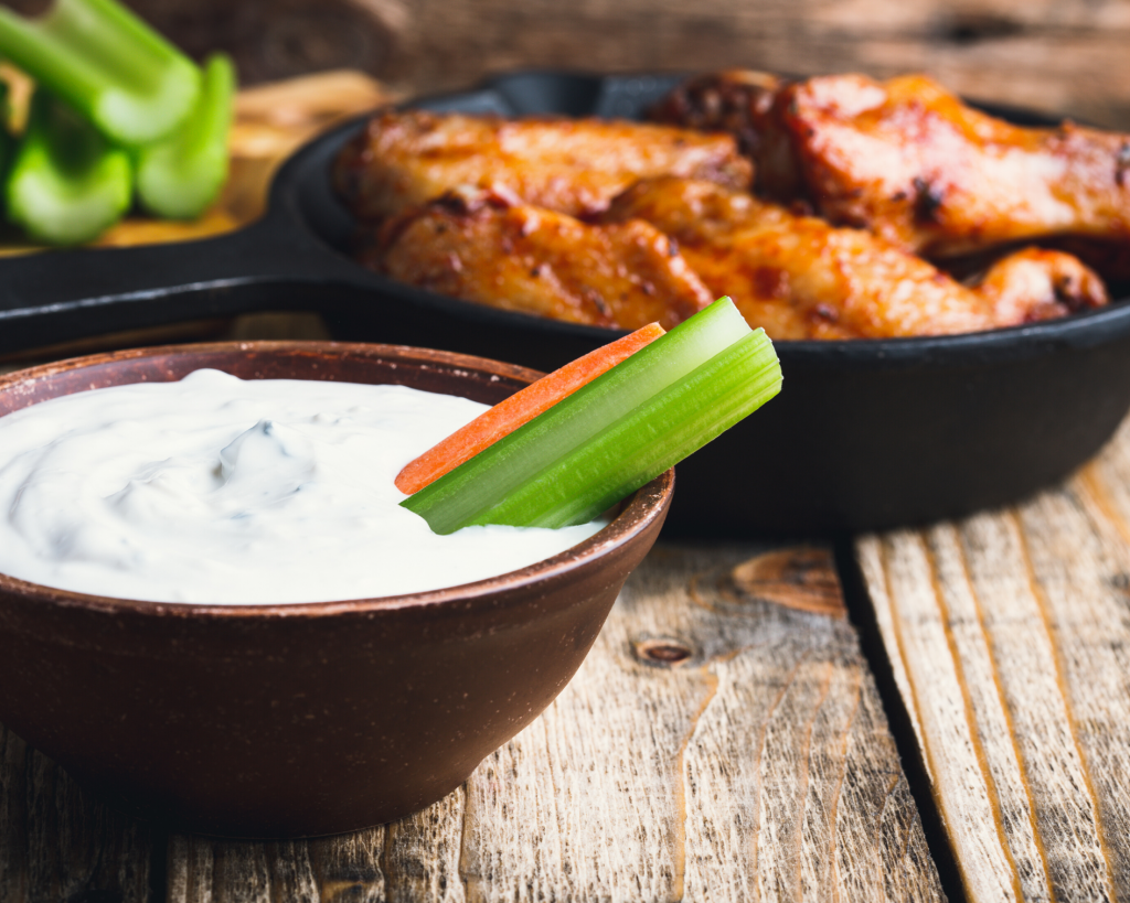 Homemade Garlic Blue Cheese Dressing served with veggies, wings, salads, and even crackers!